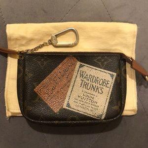 Louis Vuitton Mono Wardrobe Trunks Micro Pochette